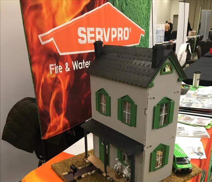 Small Model of a Two Story House with the SERVPRO Banner at an Exhibit