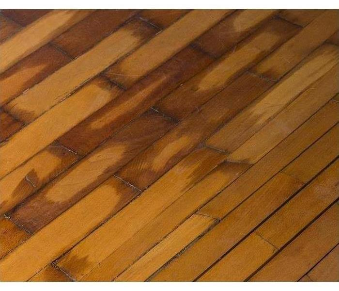 Water soaked hardwood flooring