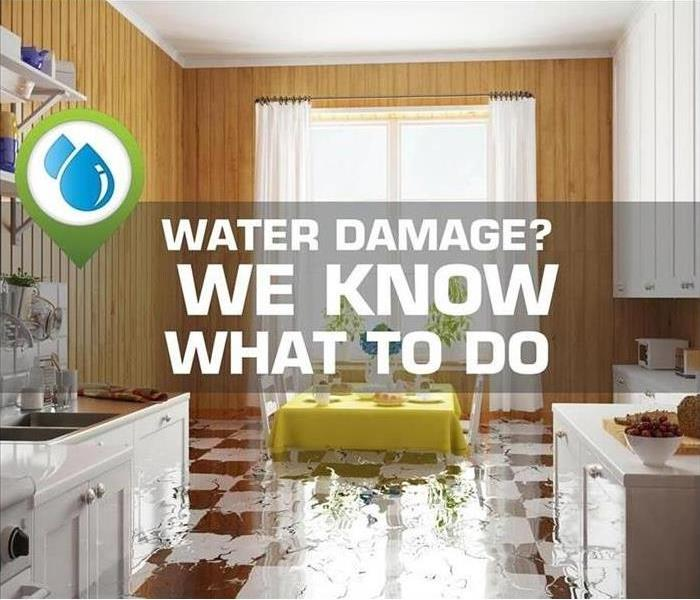 "Kitchen with water damage and the words ""water damage?  We know what to do"""