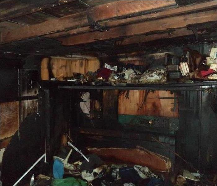 A garage filled with soot and smoke damage after a fire